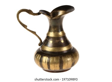Ancient graceful bronze jug of manual work. Isolated