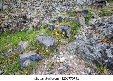 Ancient granite stone staircase at spring with grass and blossoming flowers near the Studen Kladenetz dam in Rhodope Mountains, Bulgaria