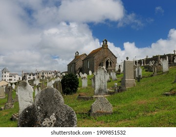 Ancient Gravestones And Old Chapel At Barnoon Cemetery St Ives Cornwall England On A Sunny Summer Day With A Few Clouds In The Sky