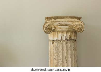 ancient Greece architecture object marble column on white wall background with empty space for copy or your text