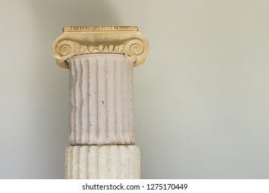 ancient Greece history museum tourist and sightseeing concept, marble column antique architecture example exhibit object on white wall background, copy space