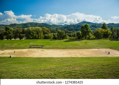 ancient Greece stadium world heritage touristic site, travel sightseeing concept, park outdoor spring floral natural environment