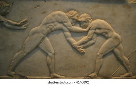 Ancient Greek Bas relief of men wrestling