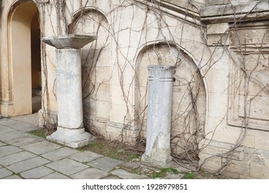 ancient greek building with antique columns and arched windows.