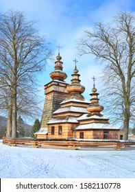 Ancient greek catholic wooden church in Kwiaton village at winter time - a classic example of Lemko church architecture,  UNESCO, Low Beskids (Beskid Niski), Poland
