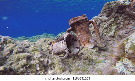 Ancient Greek Clay Amphorae Relics On Rocky Seabed, With A Deep Blue Sea Horizon. Underwater Aegean Sea, Kythira, Greece.