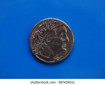 ancient greek coin over a blue background