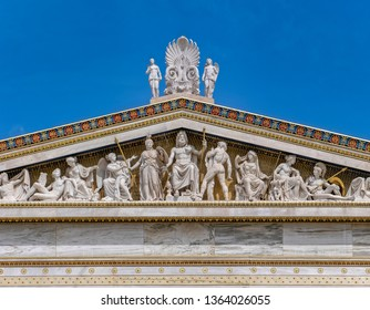 ancient Greek gods and deities statues in Neo classical pediment of the national academy of Athens Greece under clear blue sky, space for text