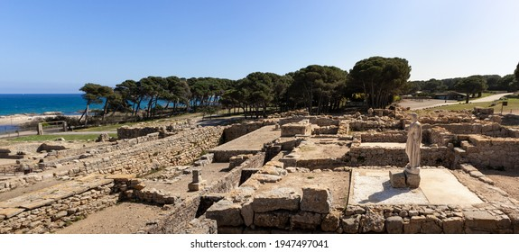 Ancient greek and roman ruins by the Mediterranean sea, famous archaeological site in Empúries, statue of Asclepius god of medicine in ancient Greek mythology, Costa Brava, Spain. Panorama picture - Shutterstock ID 1947497041