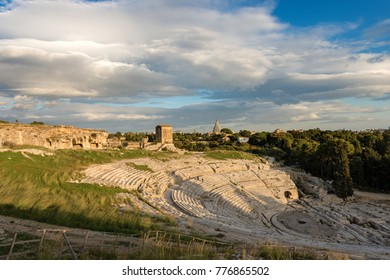 Ancient Greek Roman theater at sunset in Syracuse city (Siracusa), Sicily island, Italy (V century BC)