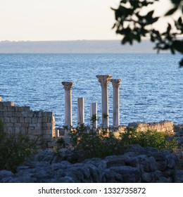 Ancient Greek ruins in Chersonesus, Crimean peninsula. Khersones against the sea background