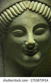 Ancient Greek Sculpture of a Goddess, probably Persephone wearing an enigmatic smile. About 2,600 years old