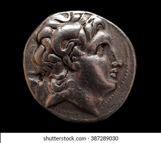 Ancient Greek silver coin of Lysimachus on a black background, closeup macro shot, selective focus