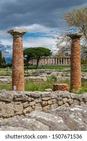 The ancient greek temple of Athena or Temple of Ceres, (c. 500 BC), between two brick's columns in the archaeological park of Paestum, Italy