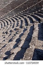 Ancient Greek theatre, Epidaurus, Peloponnese, Greece. Detail of concentric patterns.