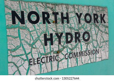 Ancient green sign for North York Hydro on an abandoned junkyard truck Rockwood, Ontario, Canada - March 27, 2011