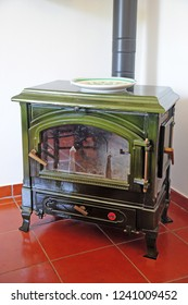 ancient green wood stove for cooking and warming up home