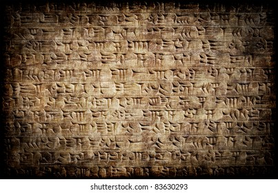 Ancient grunge cuneiform assyrian or sumerian inscription on a clay tablet