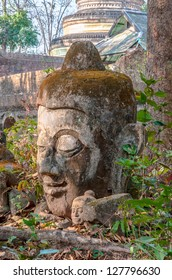 Ancient Head Buddha statue in Umong Temple at Chiangmai province, Thailand.