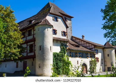 Ancient Hegi castle in the town Winterthur, Switzerland. General view, outside on a blue sky background in a summer day. Tourist attraction, tourist destination.