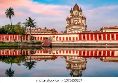Ancient Hindu temple of Goddess Kali at Kolkata Dakshineshwar at sunset with adjoining pond