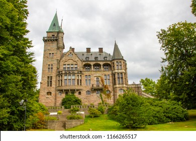 The ancient and historic Teleborg Castle in Vaxjo in the region Smaland in Sweden is a famous tourist destination on a cloudy summer day.
