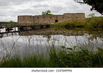 Ancient and historical Kronoberg castle on a cloudy day in Smaland , Sweden, near Vaxjo. It is an old ruin and used to be a fortress for defense and protection with the lake Helgasjon surrounded by