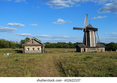 "The ancient house from a felling and a windmill in the Lermontovsky memorial estate ""Tarkhany"" of the Penza region. Russia"