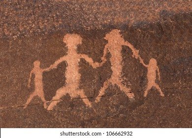 Ancient Indian petroglyph rock art family in Nevada's vast Mojave desert.