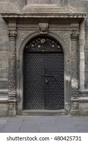 Ancient iron door with fluted columns petterned fretwork
