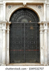 Ancient iron gate with marble surround, Venice, Italy