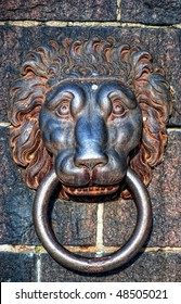 An ancient iron lions head door knocker situated at the town hall in stockholm, Sweden.