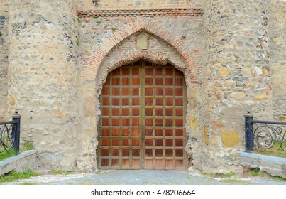 ancient iron and wooden door, entrance to Svetitskhoveli orthodox church, Georgia Mtskheta