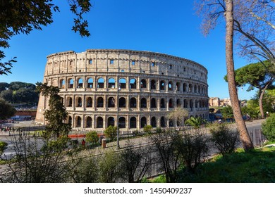 Ancient Italian monument of the Colosseum in Rome. View from the park.