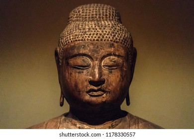 Ancient Japanese Buddah statue isolated close up detail