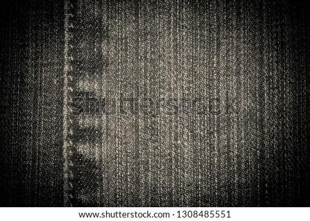Ancient jeans stylish background vignette, black. Basis for design or text.