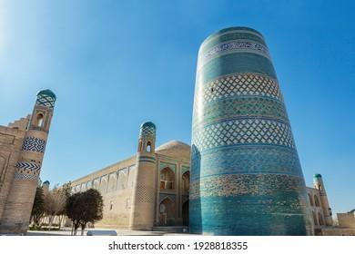 The ancient Kalta Minor tower of the Madrasah of Muhammad Aminhon in Khiva, Uzbekistan