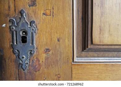 Ancient keyhole on wooden door