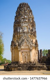Ancient Khmer prang on the ruins of the Buddhist temple Wat Phra Pai Luang close up on a sunny day. Sukhothai, Thailand