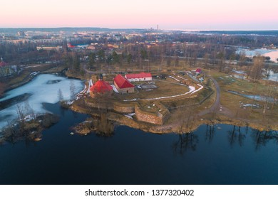 The ancient Korela fortress in the cityscape on April evening (aerial photography). Priozersk, Russia