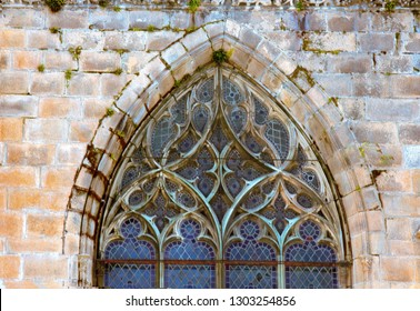 Ancient lanceolate window (ogive window) with stained glass, Gothic style temple in Limoges, France