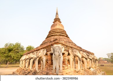 An ancient laterite/sandstone pagoda in Sukhothai's UNESCO world heritage historical park with elephant sculptures all around four sides. The place is public property, no release document required