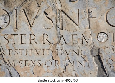 Ancient latin script carved into marble. Ruins at Pompeii, Italy