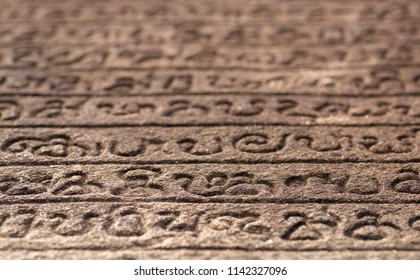 Ancient letter with words on Sinhalese language, on wall of 12th century stone temple of