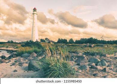 Ancient lighthouse in the dunes of the Baltic