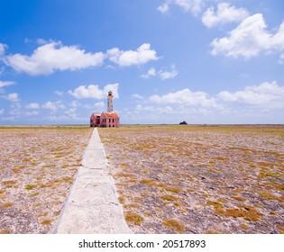 ancient lighthouse ruin on little curacao against blue cloudy sky