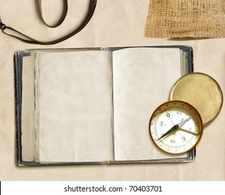 ancient logbook and compass on faded paper, copyspace