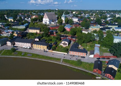 Ancient Lutheran cathedral in a city landscape in the sunny July afternoon (aerial photography). Porvoo, Finland
