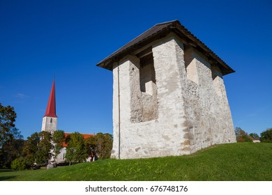 Ancient Lutheran church and bellfry in Kihelkonna, Saaremaa, Estonia. Early autumn sunny day. Landscape view.
