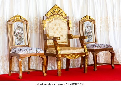 Ancient luxury golden chair on red carpet floor and curtain background